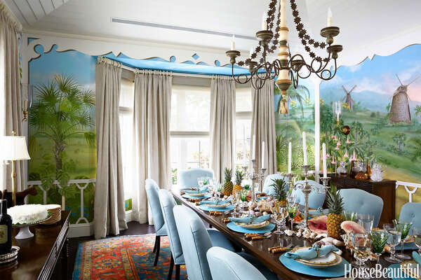 Dining Room  In the dining room, Edward Ferrell + Lewis Mittman chairs in Schumacher's Hampton Court Diamond surround a hand-carved teak table made in India. Curtains in Blithfield's Beasties from Lee Jofa.      15 Genius DIY Storage Solutions   A Colorful and Whimsical Winter Escape in Palm Beach   80 + Bedroom Decorating Inspiration   The 2015 Color Trends You NEED to Know Now   Inside a Lake House With Stunning Color   8 Quick Ways To Create A Comfortable Guest Room