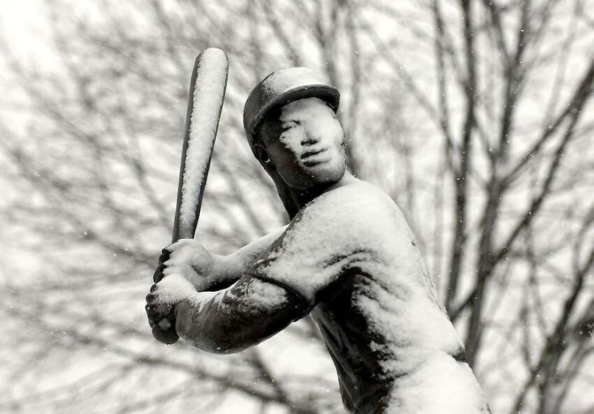 The Statute of baseball legend Jackie Robinson covered with snow in Jackie Robinson Park, Stamford, Friday morning, Feb. 26th, 2010.