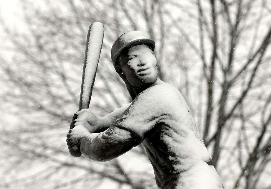 The Statute of baseball legend Jackie Robinson covered with snow in Jackie Robinson Park, Stamford,  Friday morning, Feb. 26th, 2010. Photo: Bob Luckey / Stamford Advocate