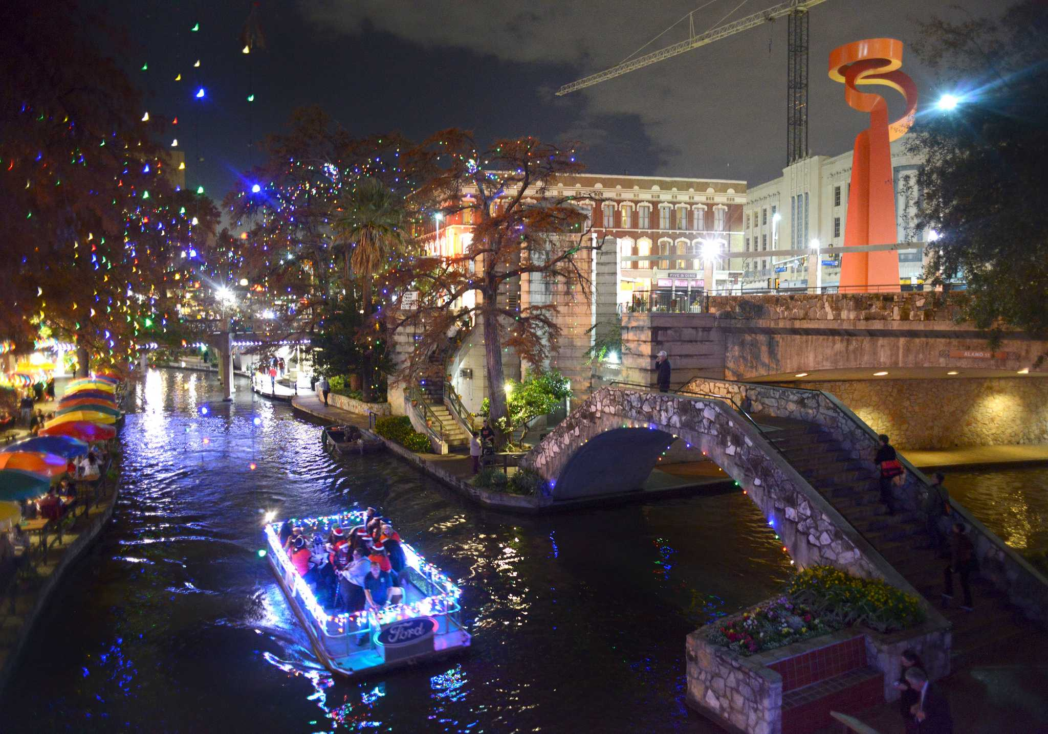 Holiday Lights Differ On Downtown River Walk And Museum