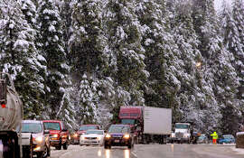 Traffic moves slowly as it is directed through a chain checkpoint along Interstate 80 near the Placer County town of Baxter.