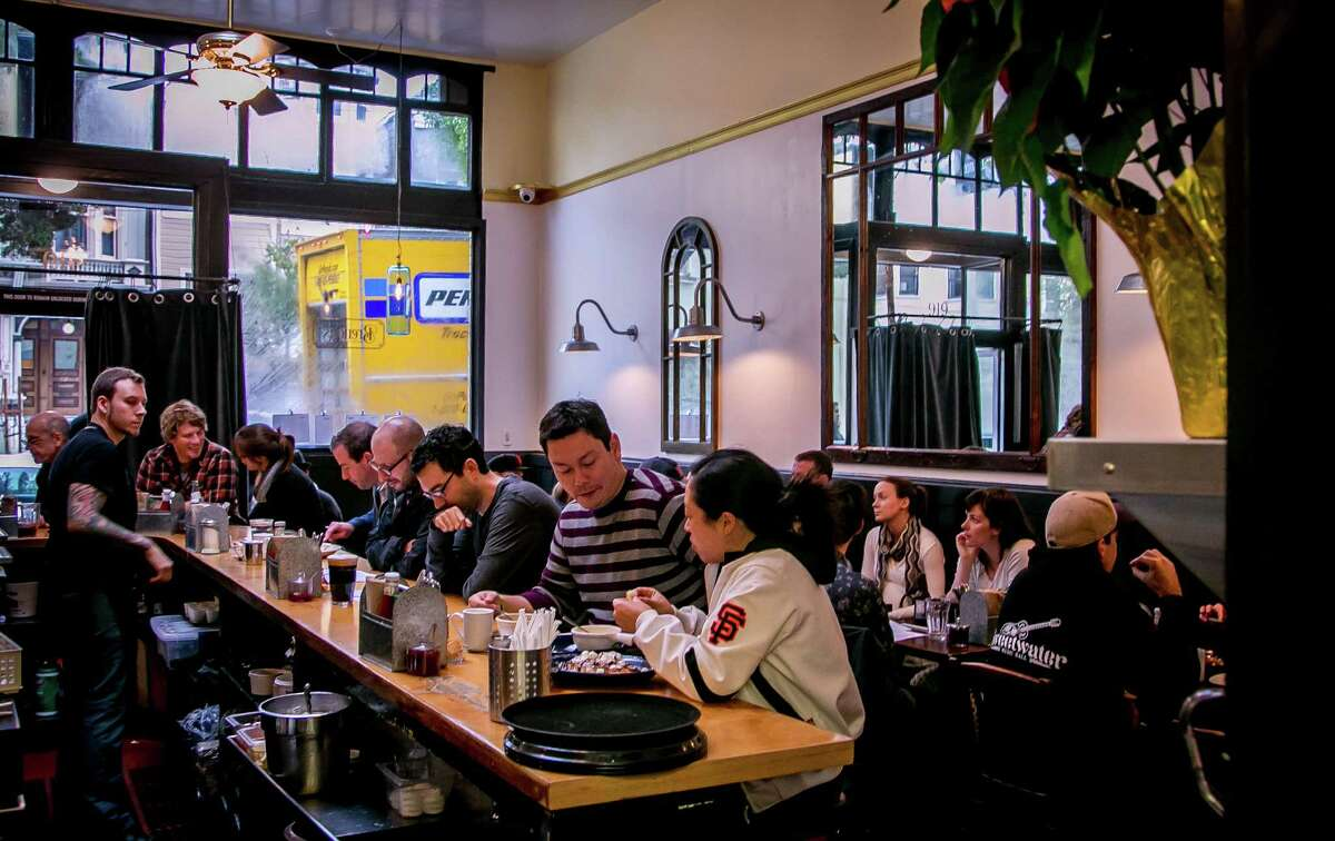 Diners have lunch at the J-shaped counter at Brenda's Meat & Three in San Francisco.
