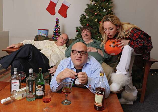From left, Michael Burns, Peter Delocis, Norm Eick and  Heather Jakeman of The Mop & Bucket improv company pose for a photo shoot on how not to take a holiday family photo at the Times Union on Monday, Nov. 1, 2014 in Colonie, N.Y. (Lori Van Buren / Times Union) Photo: Lori Van Buren / 00029658A