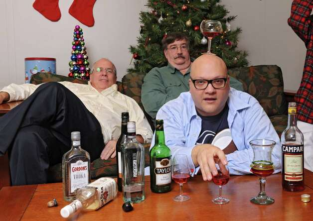 From left, Michael Burns, Norm Eick and Peter Delocis of The Mop & Bucket improv company pose for a photo shoot on how not to take a holiday family photo at the Times Union on Monday, Nov. 1, 2014 in Colonie, N.Y. (Lori Van Buren / Times Union) Photo: Lori Van Buren / 00029658A