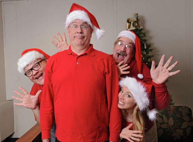 From left, Peter Delocis, Michael Burns, Norm Eick and Heather Jakeman of The Mop & Bucket improv company pose for a photo shoot on how not to take a holiday family photo at the Times Union on Monday, Nov. 1, 2014 in Colonie, N.Y. (Lori Van Buren / Times Union) Photo: Lori Van Buren / 00029658A