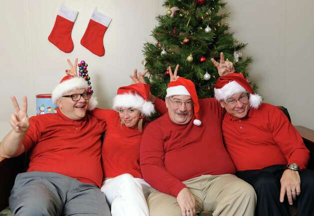 From left, Peter Delocis, Heather Jakeman, Norm Eick and Michael Burns of The Mop & Bucket improv company pose for a photo shoot on how not to take a holiday family photo at the Times Union on Monday, Nov. 1, 2014 in Colonie, N.Y. (Lori Van Buren / Times Union) Photo: Lori Van Buren / 00029658A