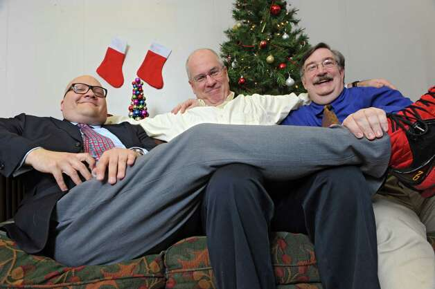 From left, Peter Delocis, Michael Burns and Norm Eick of The Mop & Bucket improv company pose for a photo shoot on how not to take a holiday family photo at the Times Union on Monday, Nov. 1, 2014 in Colonie, N.Y. (Lori Van Buren / Times Union) Photo: Lori Van Buren / 00029658A