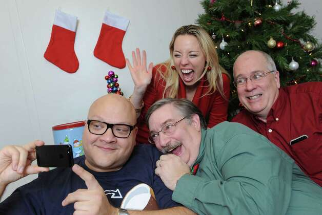 From left, Peter Delocis, Norm Eick, Heather Jakeman and Michael Burns of The Mop & Bucket improv company pose for a photo shoot on how not to take a holiday family photo at the Times Union on Monday, Nov. 1, 2014 in Colonie, N.Y. (Lori Van Buren / Times Union) Photo: Lori Van Buren / 00029658A