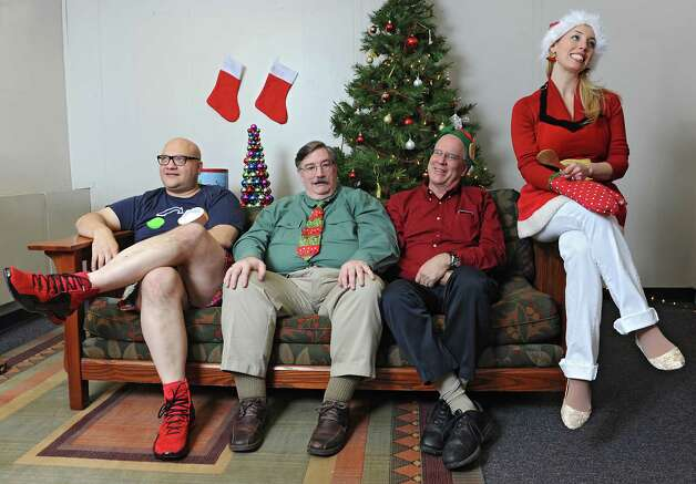 From left, Peter Delocis, Norm Eick, Michael Burns and Heather Jakeman of The Mop & Bucket improv company pose for a photo shoot on how not to take a holiday family photo at the Times Union on Monday, Nov. 1, 2014 in Colonie, N.Y. (Lori Van Buren / Times Union) Photo: Lori Van Buren / 00029658A