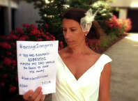 "When Courtney Davis got married last summer, she posed in her gown with a large placard: ""Message2Congress: If you had banned asbestos, maybe my dad would have been here to give me away."" Davis' father, Larry W. Davis of Southington, Conn., died in July 2012 of mesothelioma, a cancer of the lining of the chest that is 100 percent preventable because is caused by exposure to asbestos fibers."