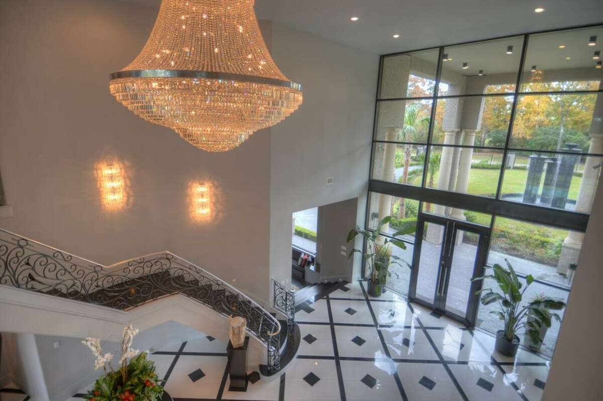 Entry. Stunning entry boast commercial grade wall of windows with views of the towering water features in the front circle drive.
