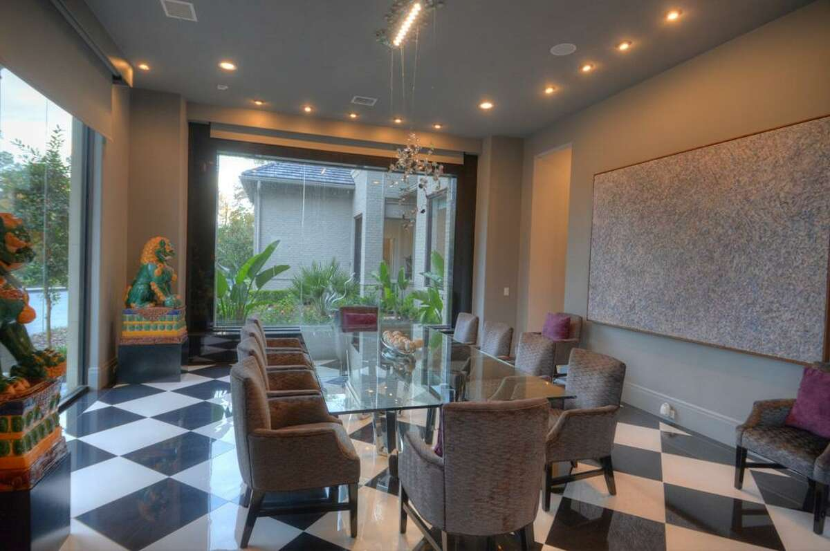 Dining. Impressive formal dining accented with Swarovski fixture and water wall.