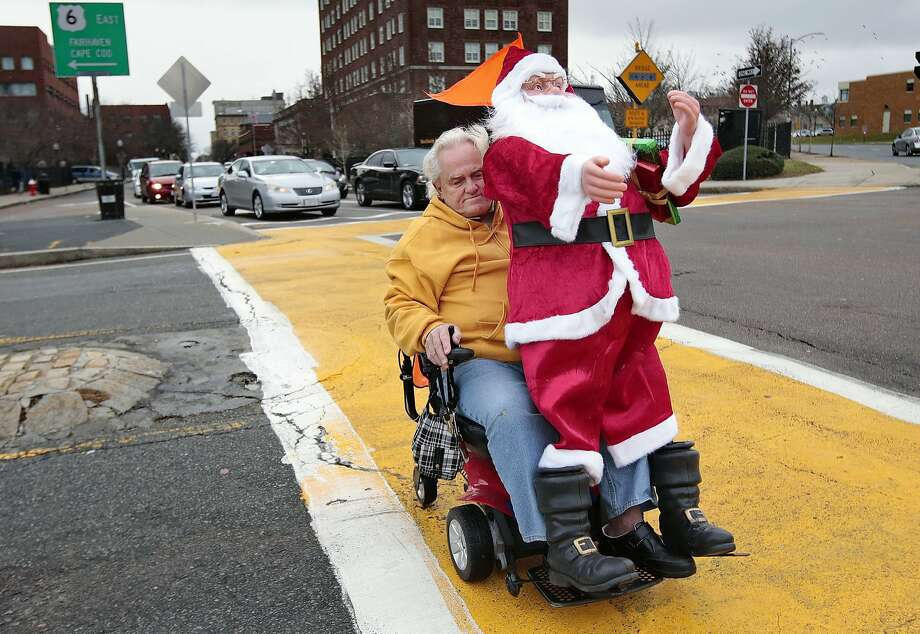 WHO'S SITTING IN WHOSE LAP NOW? THE TABLES ARE TURNED, SANTA!Ronald Parkinson says he's going to use the 5-foot-tall singing St. Nick to decorate his apartment in downtown New Bedford, Mass. Photo: Peter Pereira, Associated Press