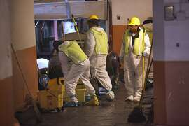 Service Master Recovery Management cleanup crew sweep debris and dehumidify the basement at 2106 Folsom Street in San Francisco, Calif., on Friday, December 12, 2014.