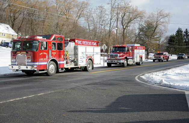 Trucks from the Pine Grove Fire Department show up to the Cunniff home on Friday, Dec. 12, 2014 in Rotterdam, N.Y. Caleb Cunniff and his family were presented an all-expense-paid trip to Florida. Trooper David Cunniff died  while on duty almost a year ago.  (Lori Van Buren / Times Union) Photo: Lori Van Buren / 00029838A
