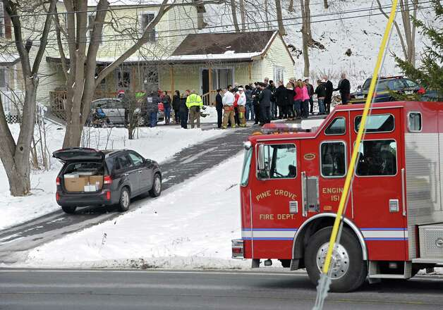 Trucks from the Pine Grove Fire Department are seen in front of the Cunniff home on Friday, Dec. 12, 2014 in Rotterdam, N.Y. Caleb Cunniff and his family were presented a trip to Florida. Trooper David Cunniff died almost a year ago  while on duty.  (Lori Van Buren / Times Union) Photo: Lori Van Buren / 00029838A