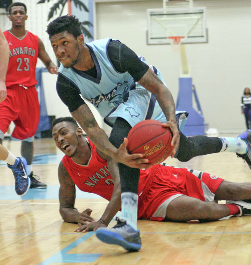 Lamar State College-Port Arthur sophomore Antonio Dawson drives to the basket during the Seahawks' game against Navarro on Wednesday night at the Parker Center in Port Arthur. Photo: Photo Provided By /Gerry L. Dickert/LSC-PA