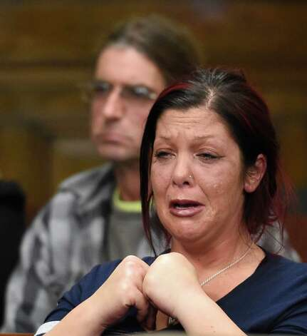 A woman identified as defendant Anthony Repp's sister is distraught after her brother pleaded guilty in Rensselaer County Court Friday morning Dec. 12, 2014 in Troy, N.Y.  for the murder of his step father and mother.    (Skip Dickstein/Times Union) Photo: SKIP DICKSTEIN / 00029809A