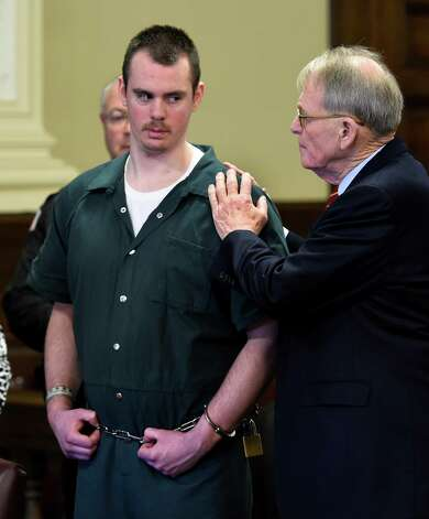 Defendant Anthony Repp in comforted by his attorney Terry Kindlon, right, after he pleaded guilty for the murder of his step father and mother Friday morning, Dec. 12, 2014, Rensselaer County Court in Troy, N.Y. (Skip Dickstein/Times Union) Photo: SKIP DICKSTEIN / 00029809A