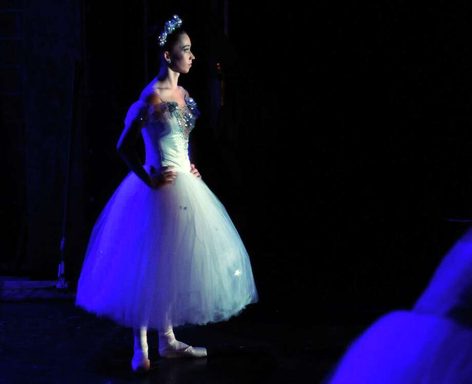 """Dancer Madeline Skelly waits for her cue backstage during rehearsals for """"The Nutcracker"""" at the Wortham Theater. Skelly made her debut as Snow Queen this season. Photo: Dave Rossman, Freelance / © 2014 Dave Rossman"""