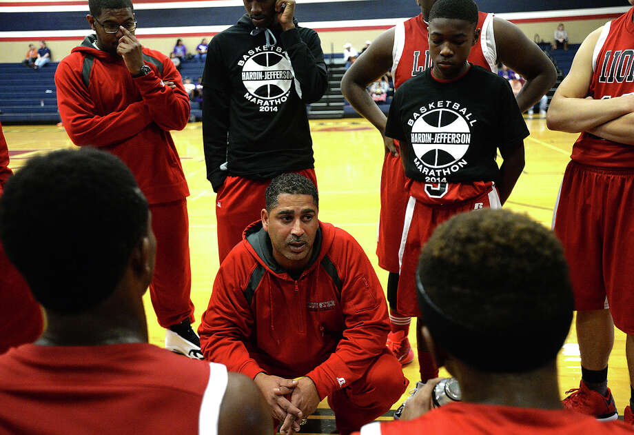Kountze head coach Duane Joubert talks to the team during a time-out with Big Sandy as they face off in the Hardin-Jefferson Basketball Marathon Thursday. A total of 16 area teams are competing in the 3-day event at the high school.  Photo taken Thursday, December 11, 2014  Kim Brent/The Enterprise Photo: Kim Brent / Beaumont Enterprise