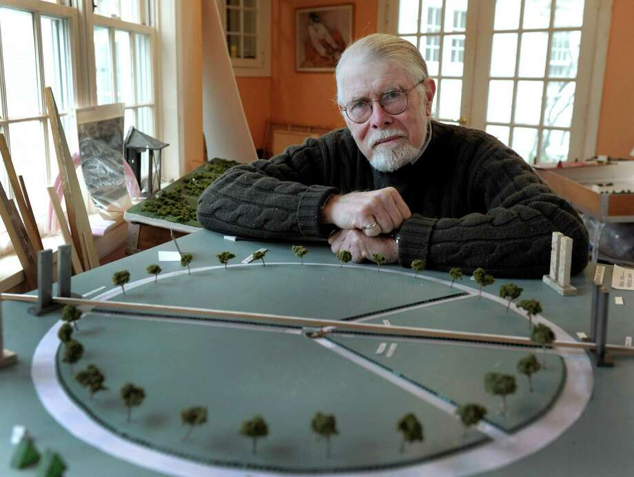 Richmond Jones has proposed an aerial-design peace sign as a permanent memorial to the victims of the Sandy Hook tragedy. He is photographed with his designs Friday, Dec. 5, 2014. Photo: Carol Kaliff / The News-Times