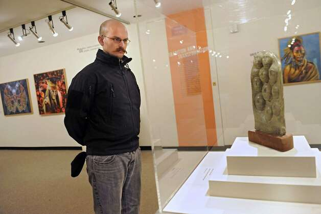 "Steven Kostusyk of Winterport, Maine looks at piece by Tom Huff titled ""Ancestors/Tree of Life"" in a new exhibition at the New York State Museum called Represent: Contemporary Native American Art on Friday, Dec. 12, 2014 in Albany, N.Y. (Lori Van Buren / Times Union) Photo: Lori Van Buren / 00029842A"