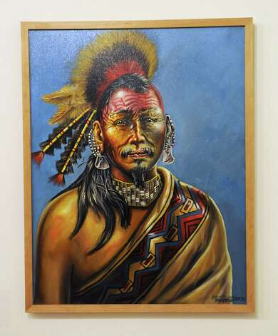 "A painting by David Bunn Martine titled ""Mandush, Shinnecock Sachem of the 17th century,"" 2007, in a new exhibition at the State Museum called Represent: Contemporary Native American Art on Friday, Dec. 12, 2014, in Albany, N.Y. (Lori Van Buren / Times Union) Photo: Lori Van Buren / 00029842A"