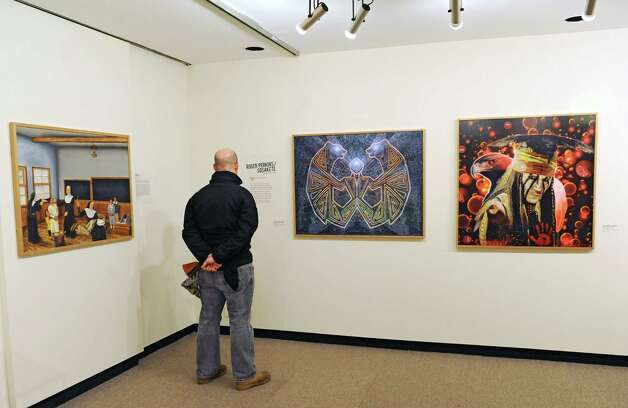 Steven Kostusyk of Winterport, Maine looks at art in a new exhibition at the State Museum called Represent: Contemporary Native American Art on Friday, Dec. 12, 2014, in Albany, N.Y. (Lori Van Buren / Times Union) Photo: Lori Van Buren / 00029842A