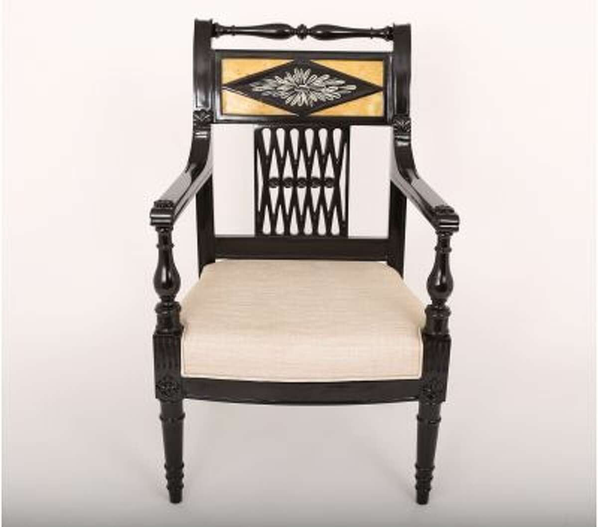 This hand-carved chair with a black ebony finish is among the items for sale on buydesignexchange.com.