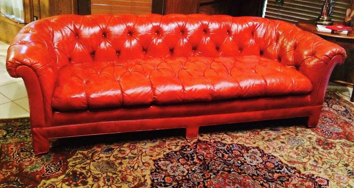 Vintage orange leather sofa at buydesignexchange.com