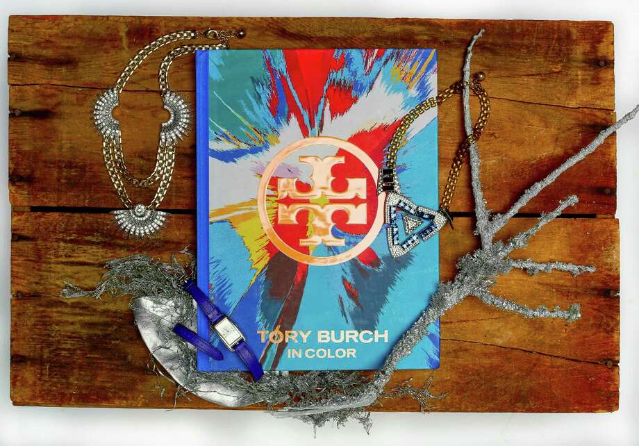 "Bold hues and a bit of sparkle: ""In Color"" by Tory Burch, $50, www.abramsbooks.com; Lulu Frost Beacon necklaces; Hermès Nantucket cobalt blue and silver double strap watch, $3,750, Hermès, 125 Grant Ave., http://www.hermes.com Photo: Russell Yip / The Chronicle / ONLINE_YES"