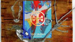 "Bold hues and a bit of sparkle: ""In Color"" by Tory Burch, $50, www.abramsbooks.com; Lulu Frost Beacon necklaces; Hermès Nantucket cobalt blue and silver double strap watch, $3,750, Hermès, 125 Grant Ave., http://www.hermes.com"