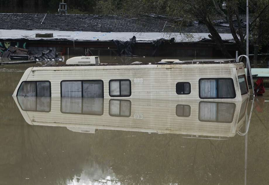 Rising water surrounds an old motor home as the Russian River floods in Guerneville, Calif. on Friday, Dec. 12, 2014. Photo: Paul Chinn, The Chronicle