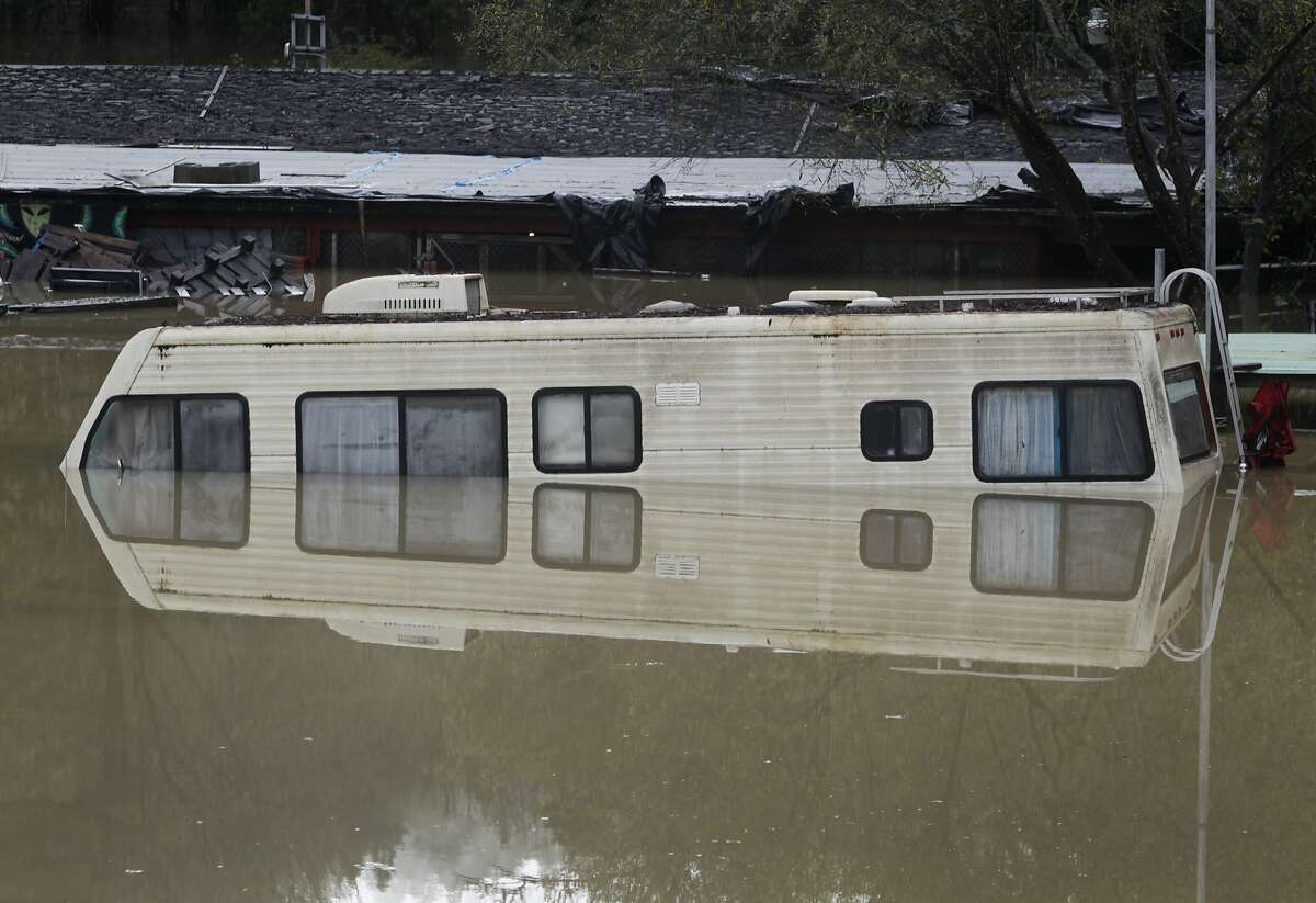 Rising water surrounds an old motor home as the Russian River floods in Guerneville, Calif. on Friday, Dec. 12, 2014.