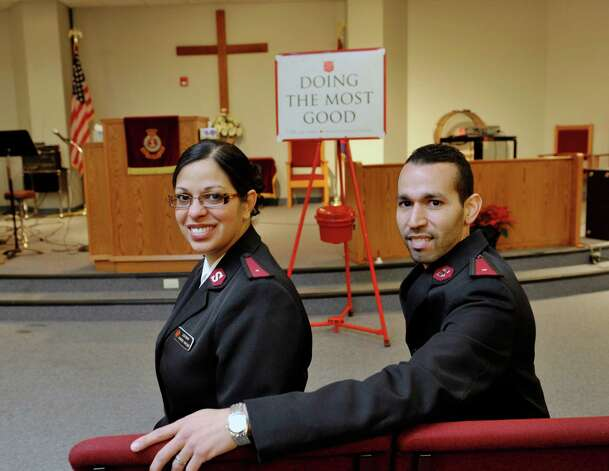 Salvation Army lieutenants, Glamaris, left, and Isaac Santiago pose for a photograph on Wednesday, Dec. 10, 2014, in Albany, N.Y.  The two corps officers/pastors lead the Albany Salvation Army and the Albany Temple Corps. (Paul Buckowski / Times Union) Photo: Paul Buckowski / 00029803A
