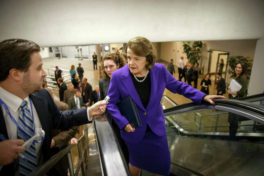 Senate Intelligence Committee Chair Sen. Dianne Feinstein, D-Calif. is pursued by reporters on Capitol Hill in Washington, Tuesday, Dec. 9, 2014, as she arrives to release a report on the CIA's harsh interrogation techniques at secret overseas facilities after the 9/11 terror attacks.  (AP Photo/J. Scott Applewhite) Photo: J. Scott Applewhite / Associated Press / AP