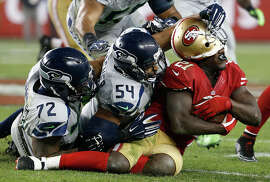 Frank Gore's hat is off to linebacker Bobby Wagner (54), end Michael Bennett (72) and the rest of Seattle's defense.