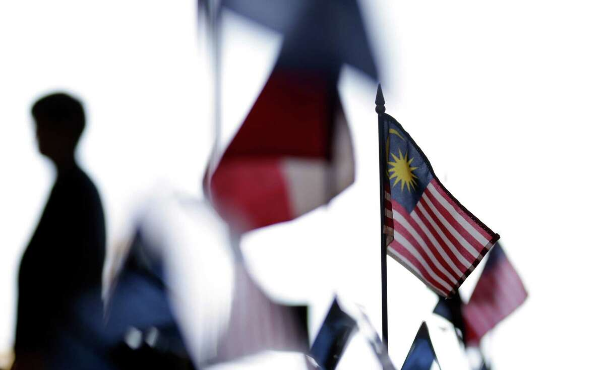 A Malaysian flag sits on a table among other flags during a news conference at the Trans-Pacific Partnership Free Trade Agreement talks in 2012. The huge agreement is a bad idea.