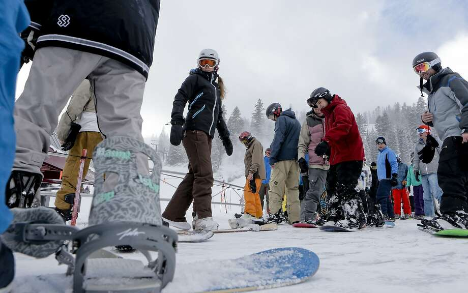 Skiers and snowboarders board the Comstock chair for a lift to the top of the mountain, to enjoy the newly fallen snow at Northstar California Resort in Truckee, Calif., on Friday Dec. 12, 2014. Photo: Michael Macor, The Chronicle