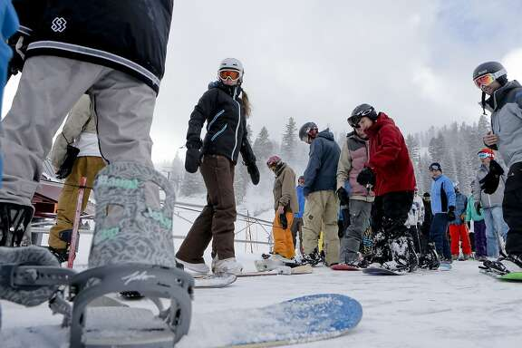 Skiers and snowboarders board the Comstock chair for a lift to the top of the mountain, to enjoy the newly fallen snow at Northstar California Resort in Truckee, Calif., on Friday Dec. 12, 2014.