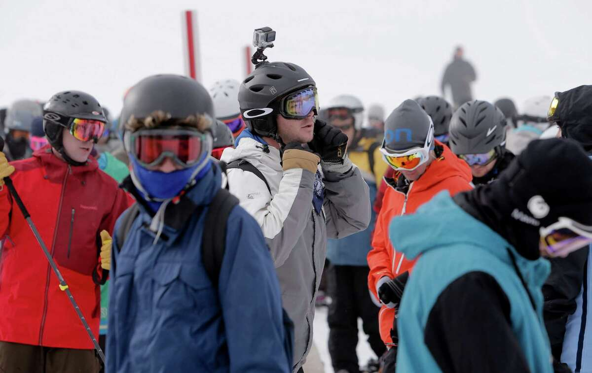 Skiers and snowboarders during a short wait for the Comstock lift as they enjoy the newly fallen snow at Northstar California Resort in Truckee, Calif., on Friday Dec. 12, 2014.