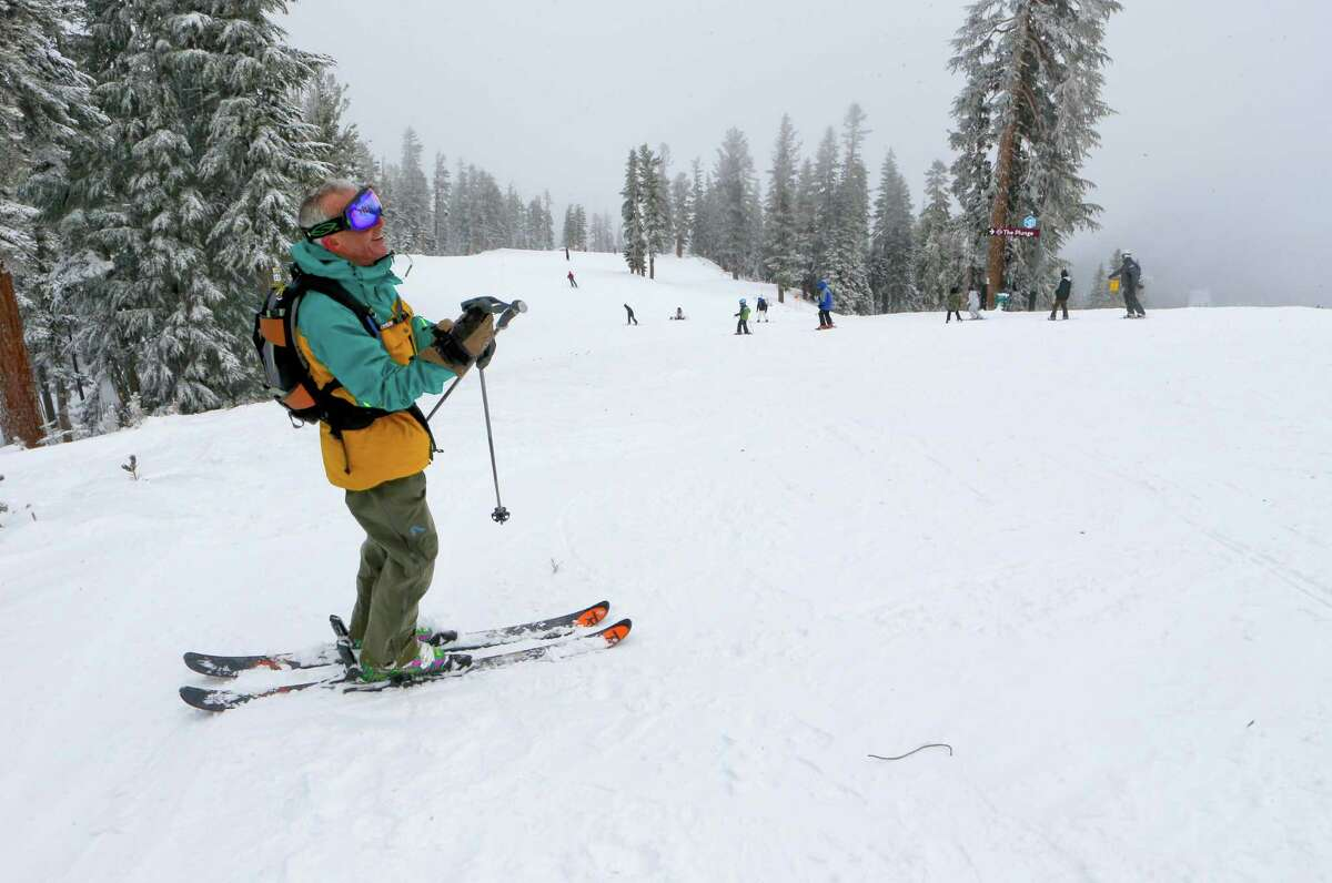 Skier Jim Dinsmore from Santa Cruz is all smiles as he prepares to take on on the newly fallen snow at Northstar California Resort in Truckee, Calif., on Friday Dec. 12, 2014.