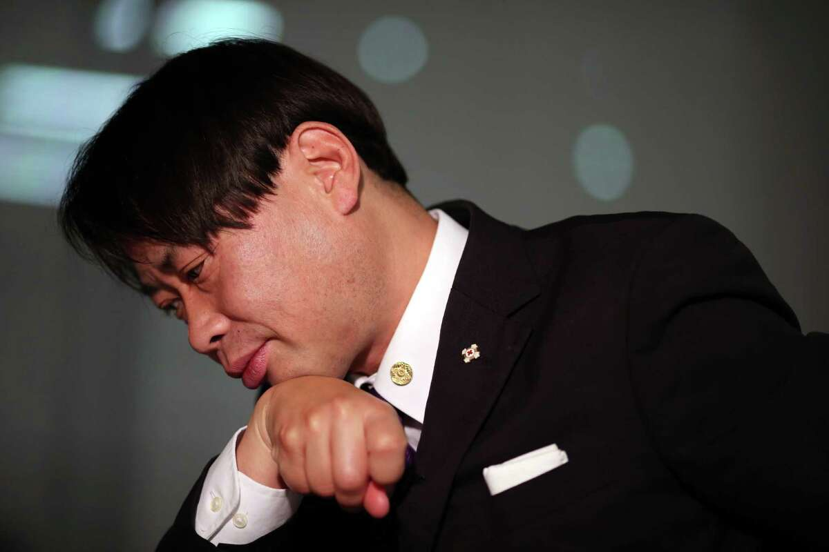 """In this Dec. 10, 2014 photo, Mutsuhiro Takeuchi, a nationalist-leaning educator and a priest in the traditional Shinto religion, pauses during an interview with The Associated Press, in Tokyo. Angelina Jolie's new movie """"Unbroken"""" has not been released in Japan yet, but it has already struck a nerve in a country still fighting over its wartime past. (AP Photo/Eugene Hoshiko)"""