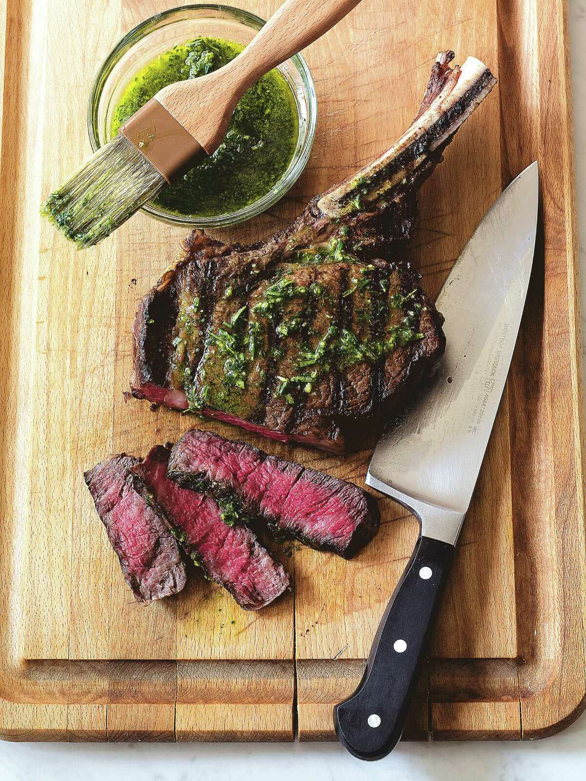 """Rib steak with an herb wash, from the cookbook """"Kosher Revolution,"""" is a centerpiece dish for a Hanukkah meal."""