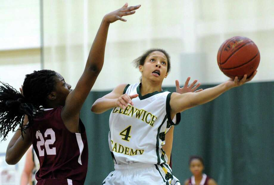 Kaitlyn Davis (#4) of Greenwich Academy scores against Florance Tshimanga (#22) of MacDuffie School during the girls high school basketball game between Greenwich Academy and MacDuffie School at Greenwich Academy, Greenwich Conn., Friday, Dec. 12, 2014. Photo: Bob Luckey / Greenwich Time