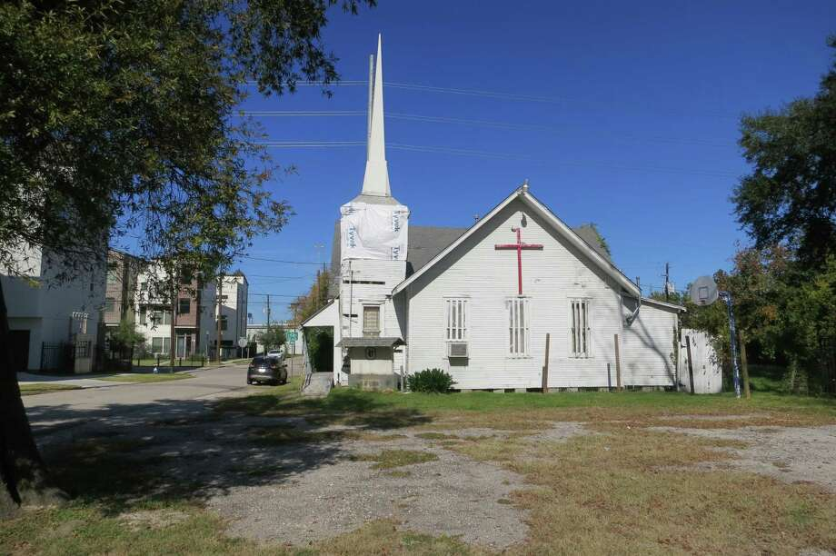 Townhouses and condos are becoming the dominant structures on the streets surrounding the Mallalieu United Methodist Church, which is soon to be razed. / Joe Holley/Houston Chronicle