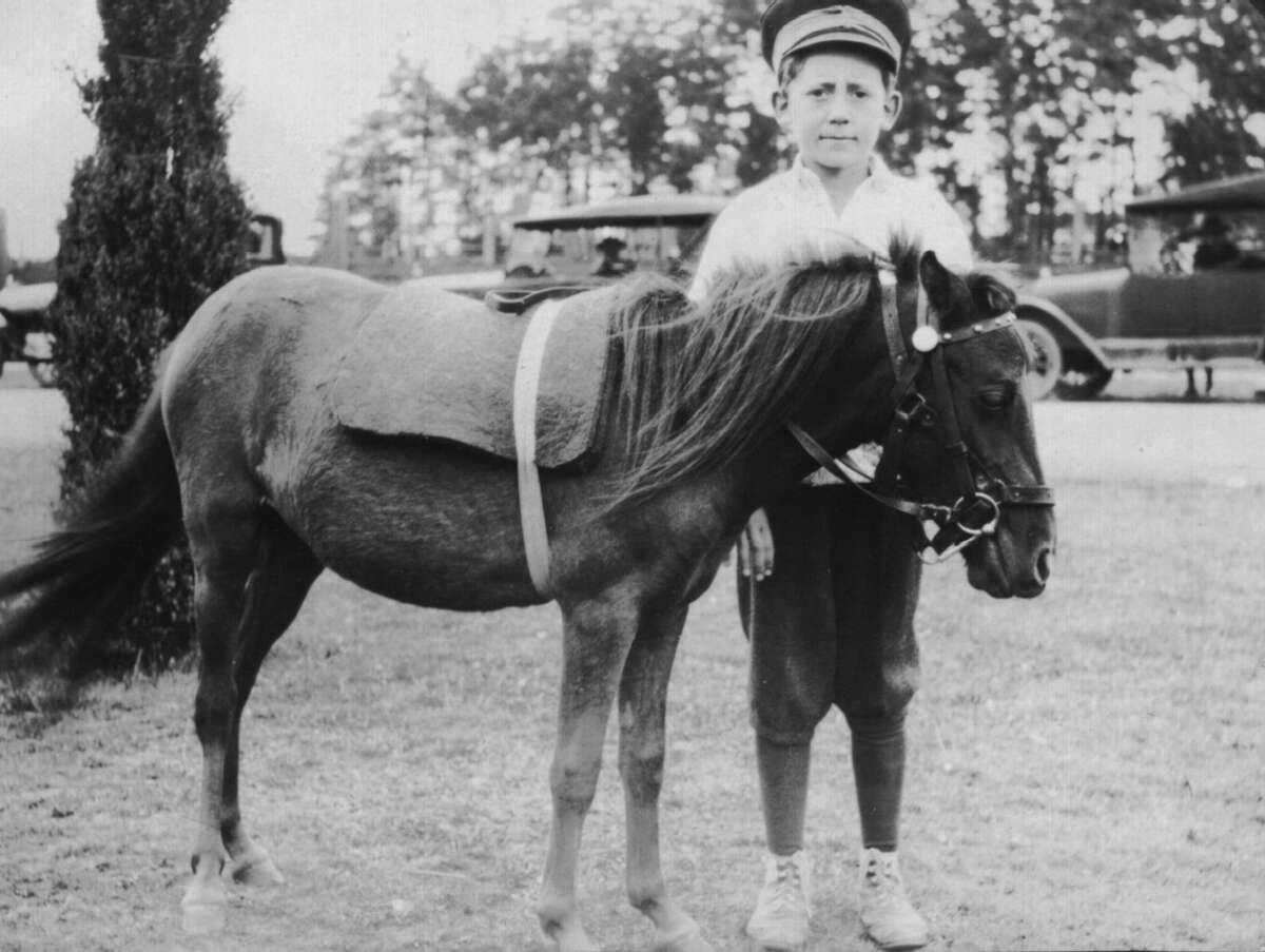In 1919, Woodland Park Zoo began offering pony rides to kids. Zoo photo, ca. 1920s.