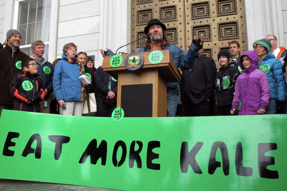 "Bo Muller-Moore speaks Friday to supporters outside the Vermont Statehouse in Montpelier about his winning a legal fight to trademark the phrase ""eat more kale"" despite initial opposition from Chick-fil-A.  Photo: Wilson Ring, STF / AP"
