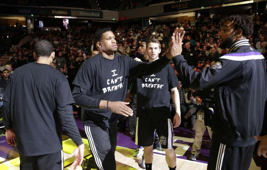 "Sacramento Kings forward Rudy Gay, second from left, was among the Kings players to wear a ""I Can't Breathe"" shirt as he is introduced before the start of an NBA basketball game against the Houston Rockets in Sacramento, Calif., Thursday, Dec. 11, 2014. Photo: Rich Pedroncelli, Associated Press"